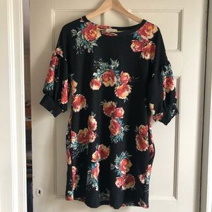 Black floral tunic dress with pockets.
